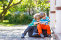 Two little sibling boys hugging and having fun outdoors Royalty Free Stock Photo