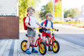 Two little siblings children having fun on bikes in city outdoo vacations outdoors Stock Photography
