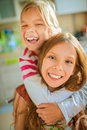 Two little sisters fun laughing Royalty Free Stock Photo