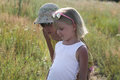 Two little sisters walking in a summer meadow at sunny day Royalty Free Stock Photo