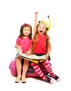 Two little super exited girls sitting suitcase map preparing to travel pointing hands snorkel mask isolated white Stock Photo