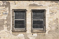 Two little windows with metallic protections Royalty Free Stock Photography