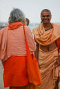 Two local monks in traditional clothes india varanasi may unidentified greeting each other on the ghats india Royalty Free Stock Images