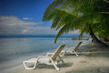 Two lounging chairs on beach Royalty Free Stock Photo