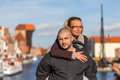 Two lovers at the historic bridge in gdansk poland love couple on background of architecture of old town Royalty Free Stock Photo