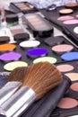 Two make-up brushes on eyeshadows palettes Stock Photos