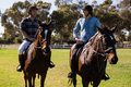 Two male friends riding horse in the ranch Royalty Free Stock Photo