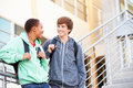 Two Male High School Students Standing Outside Building Royalty Free Stock Photo