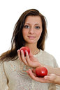 Two man's hand offering an apple to woman. Stock Photo
