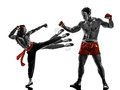 Two manga video games martial arts fighters fighting combat in silhouettes on white background Royalty Free Stock Photography