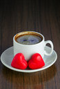 Two marzipan hearts and coffee cup of black red candy for valentine s day Stock Photography