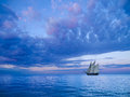 Two mast schooner ancient sailing away to the horizon Stock Images