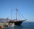 Two masted sailing boat volcano excursions brig with tourists at armeni port oia santorini greece santorini has been voted as the Royalty Free Stock Photos