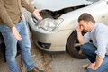 Two men arguing after a car accident on the road Royalty Free Stock Photo