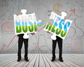 Two men assembling green business puzzles together Royalty Free Stock Photo