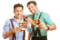 Two men in bavaria with pretzel happy holding a their hands Royalty Free Stock Photography