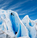 Two men climbing a glacier in patagonia. Royalty Free Stock Image