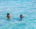 Two men in equipment for a snorkeling in the sea Stock Image