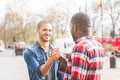 Two men giving a friendly handshake Royalty Free Stock Photo