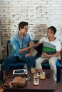 Two Men Handshake Congratulation at Cafe, Friend Royalty Free Stock Photo