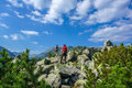 Two men hiking in the mountains on a tourist track on rocks Royalty Free Stock Photo