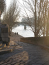 Two men jog paris france january along the river seine in morning sunlight on the right bank on january in paris france Royalty Free Stock Photography