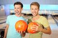 Two men make row from balls in bowling club Stock Images