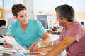 Two Men Meeting In Creative Office Royalty Free Stock Photo