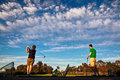 Two men practicing their golf swing at a driving range Royalty Free Stock Photo