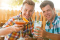 Two men resting at caffe drinking coctails in summer Stock Photo