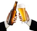 Two men's hands with a glass and a bottle of beer Royalty Free Stock Images
