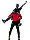 Two men soccer player goalkeeper celebration silhouette in isolated white background Stock Photo