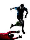 Two men soccer player goalkeeper competition silhouette caucasian in white background Stock Images