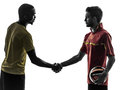 Two men soccer player  handshake handshaking silhouette Royalty Free Stock Photo