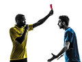 Two men soccer player and referee showing red card silhouette in on white background Stock Image