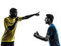 Two men soccer player and referee standing silhoue in silhouette on white background Stock Photo