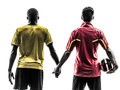 Two men soccer player standing holding hands silhouette playing football competition hand in hand in on white background Stock Photo
