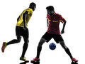 Two men soccer player standing silhouette playing football competition in on white background Royalty Free Stock Photography