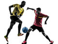Two men soccer player standing silhouette playing football competition in on white background Stock Photography
