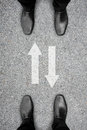Two men standing and two way sign Royalty Free Stock Photo