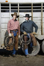 Two Men Wearing Cowboy Hats Holding Lariats Royalty Free Stock Images