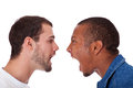 Two men yelling at each other young all on white background Royalty Free Stock Images
