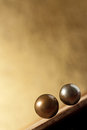 Two metal balls on sloping surface Stock Photo