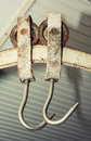 Two metal hooks in a factory Stock Photo