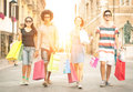 Two mixed race couples making shopping Royalty Free Stock Photo