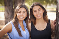 Two mixed race twin sisters portrait beautiful outdoors Stock Image