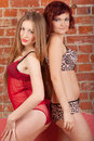 Two models pose back to back Royalty Free Stock Images