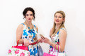 Two models standing with shopping bags and smart phone Royalty Free Stock Photo
