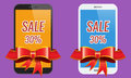 Two modern touch-screen mobile phones with ribbon sale banner. Royalty Free Stock Photo