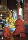 Two monk are praying in front of the statue buddha Royalty Free Stock Image